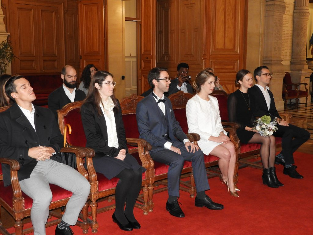 French civil ceremony witnesses sitting beside bride and groom