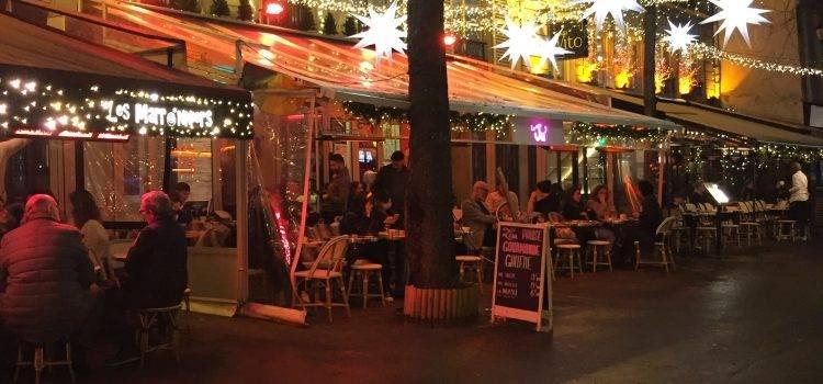 lights illuminated an outdoor terrasse in Paris