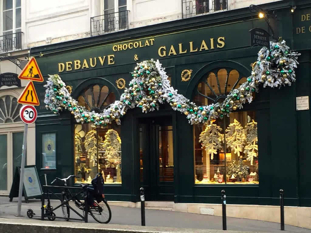 Christmas decorations draped outside of Paris store