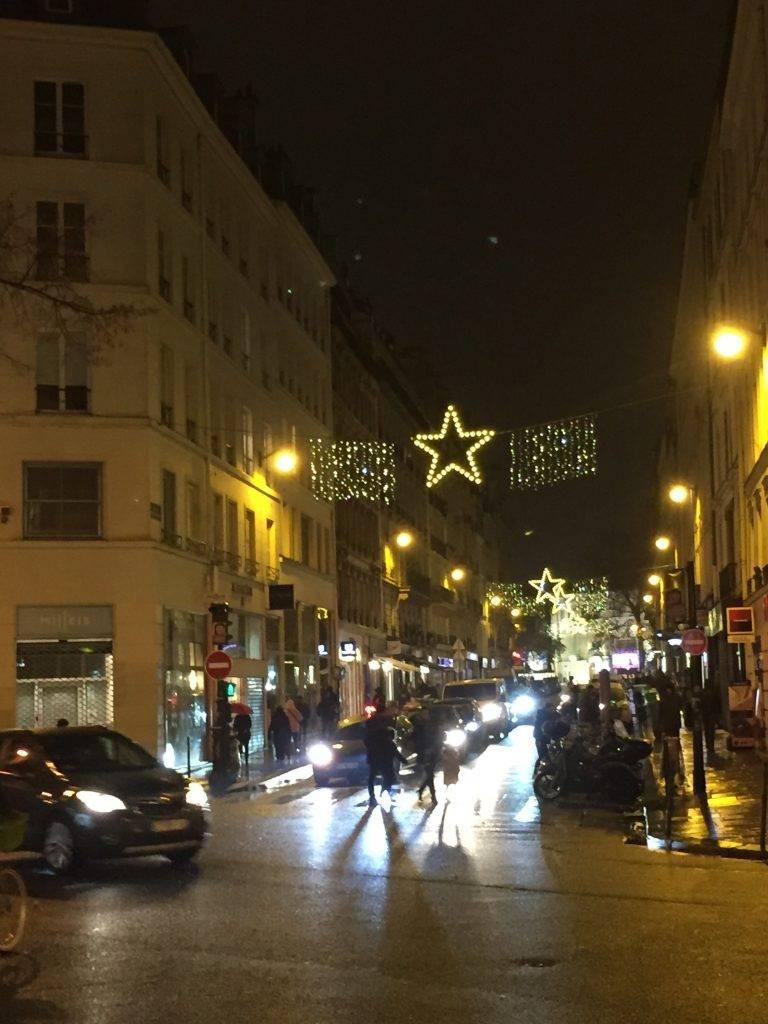 Christmas lights strung across Paris street