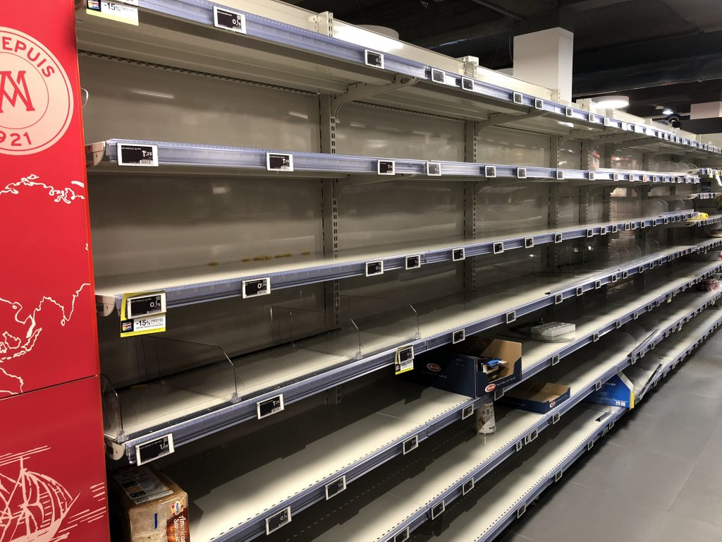 bare shelves in grocery store before confinement in Paris