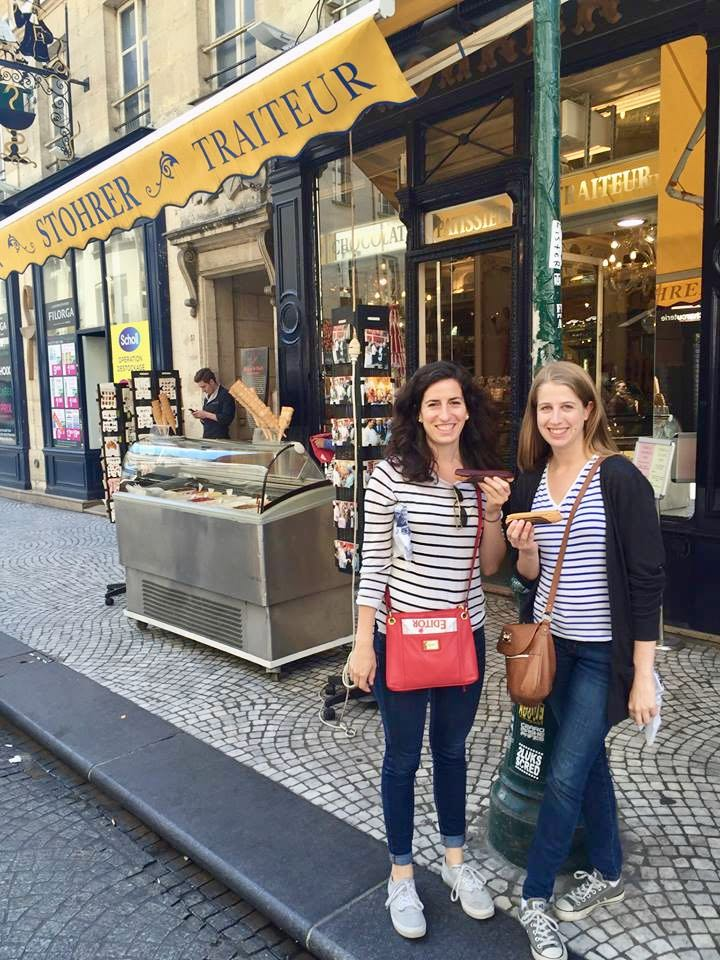Joanna and Ellen eating éclairs outside of Stohrer in Paris
