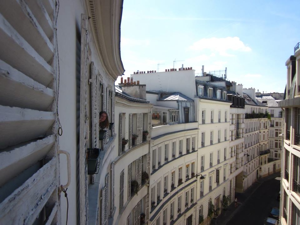 view of apartment buildings on Rue Laferrière in Paris