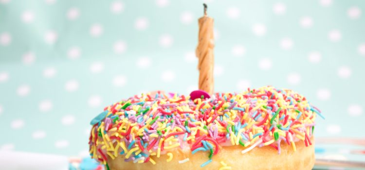 birthday donut with sprinkles one candle