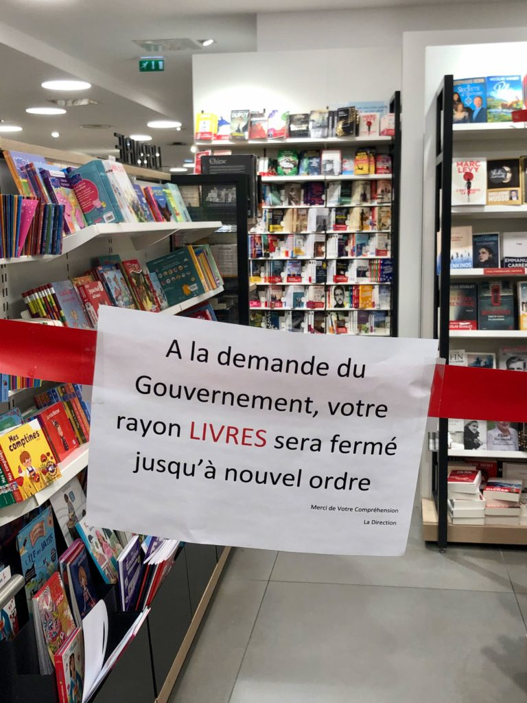 sign: book aisle is closed until further notice by order of the government