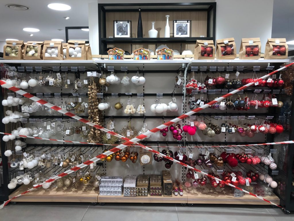 Christmas ornaments on shelved, taped off during confinement in France