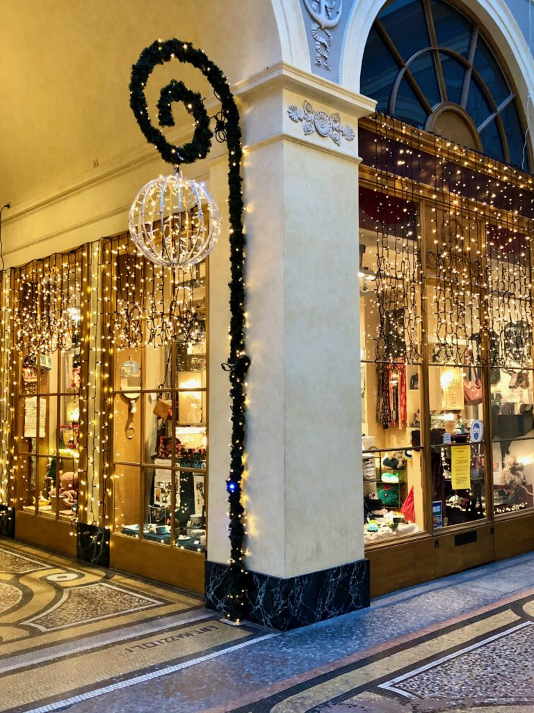Inside Galerie Vivienne decorated with white lights Christmas 2020