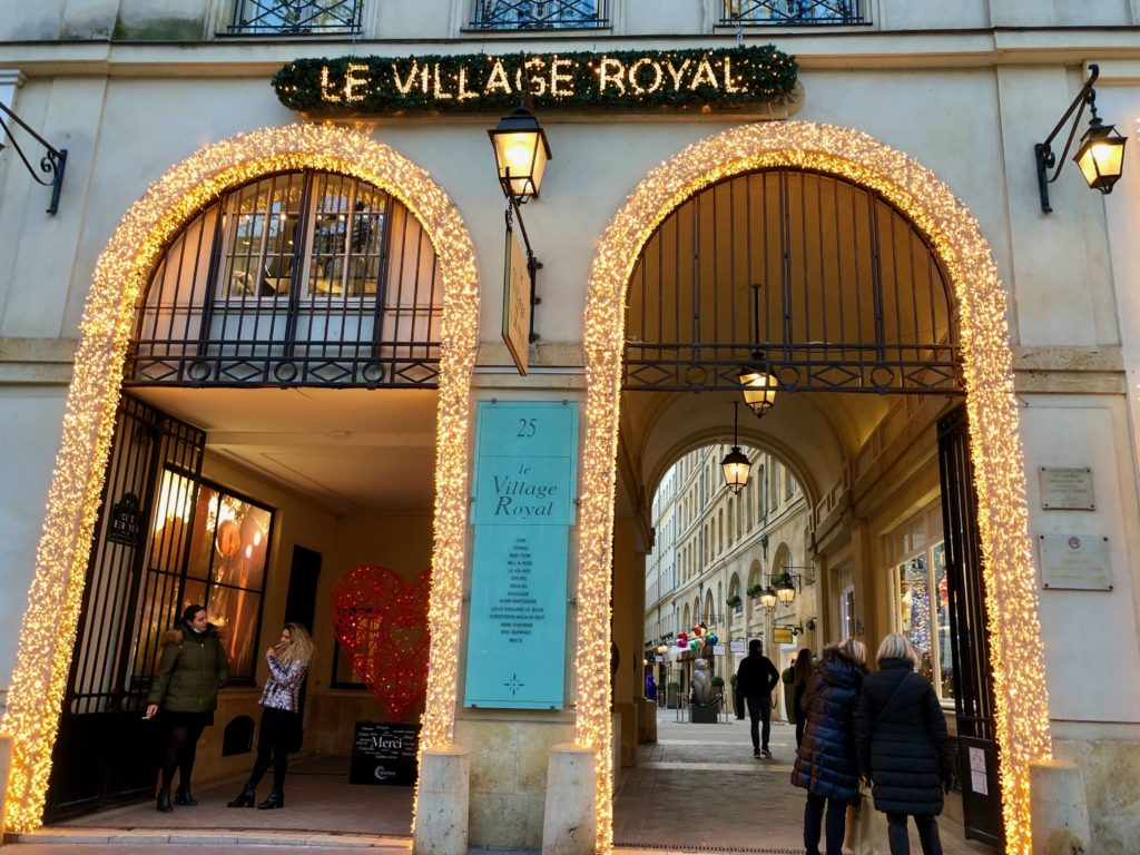entrance to Le Village Royal outlined in white lights, Christmas 2020