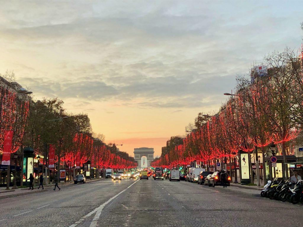 Avenue des Champs Élysées, lined with red lights, Christmas 2020, looking at Arc de Triomphe