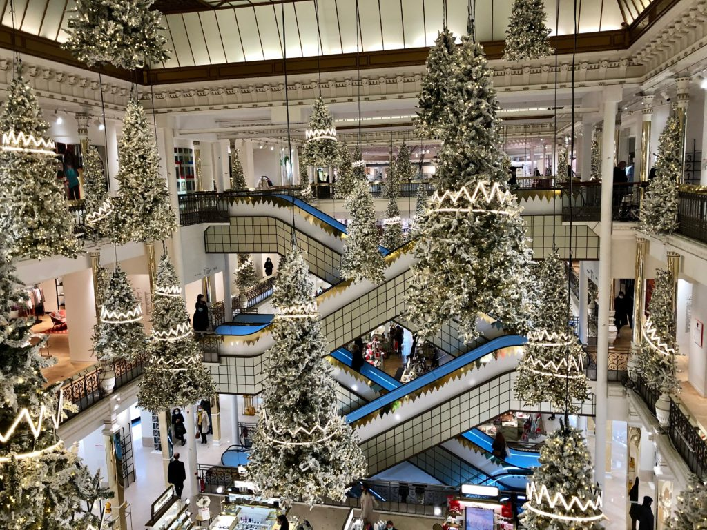 Le Bon Marché Paris department store at Christmas time with suspended trees and white lights 2020