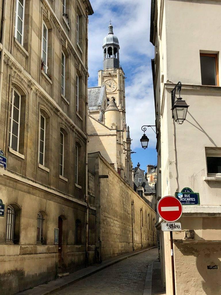 View of Saint-Étienne-du-Mont church bell tower in Paris from Rue Descartes