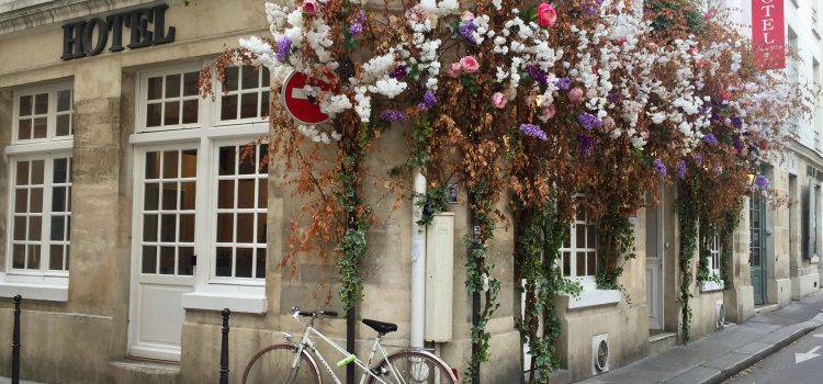 Hotel Jeanne d'Arc in the Marais decorated with flowers and a bike outside