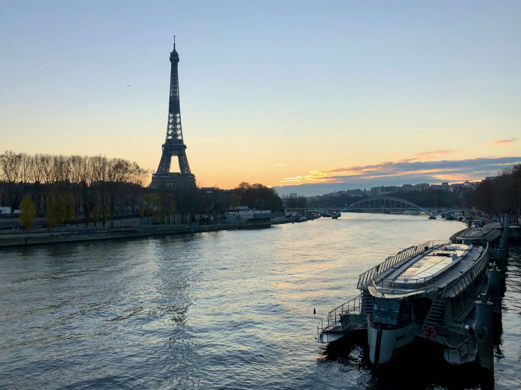 looking across the Seine river at the Eiffel tower at sunset
