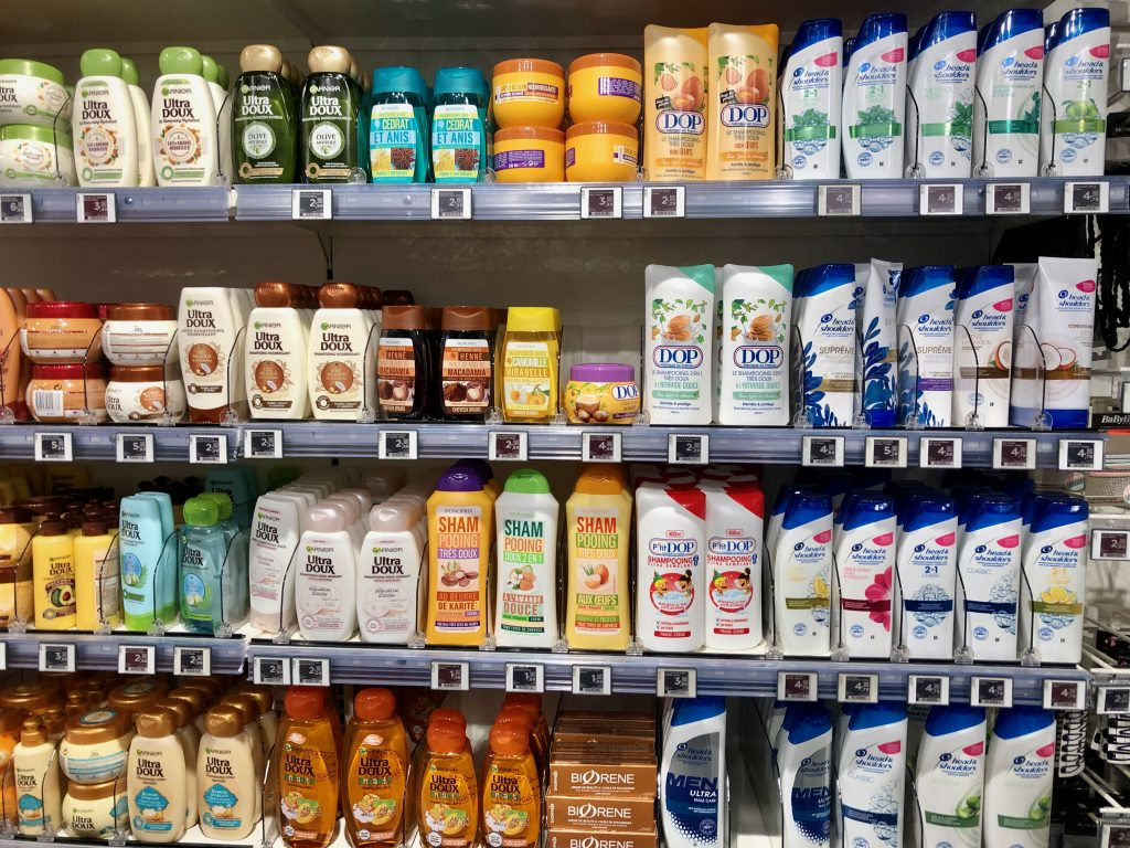 bottles of shampoo in grocery store in Paris, France