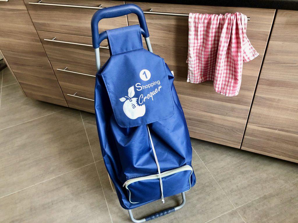 blue rolling shopping caddy