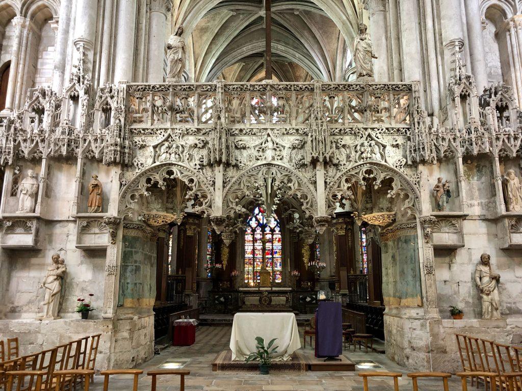 ornate stone rood screen inside Église Sainte-Madeleine in Troyes, France