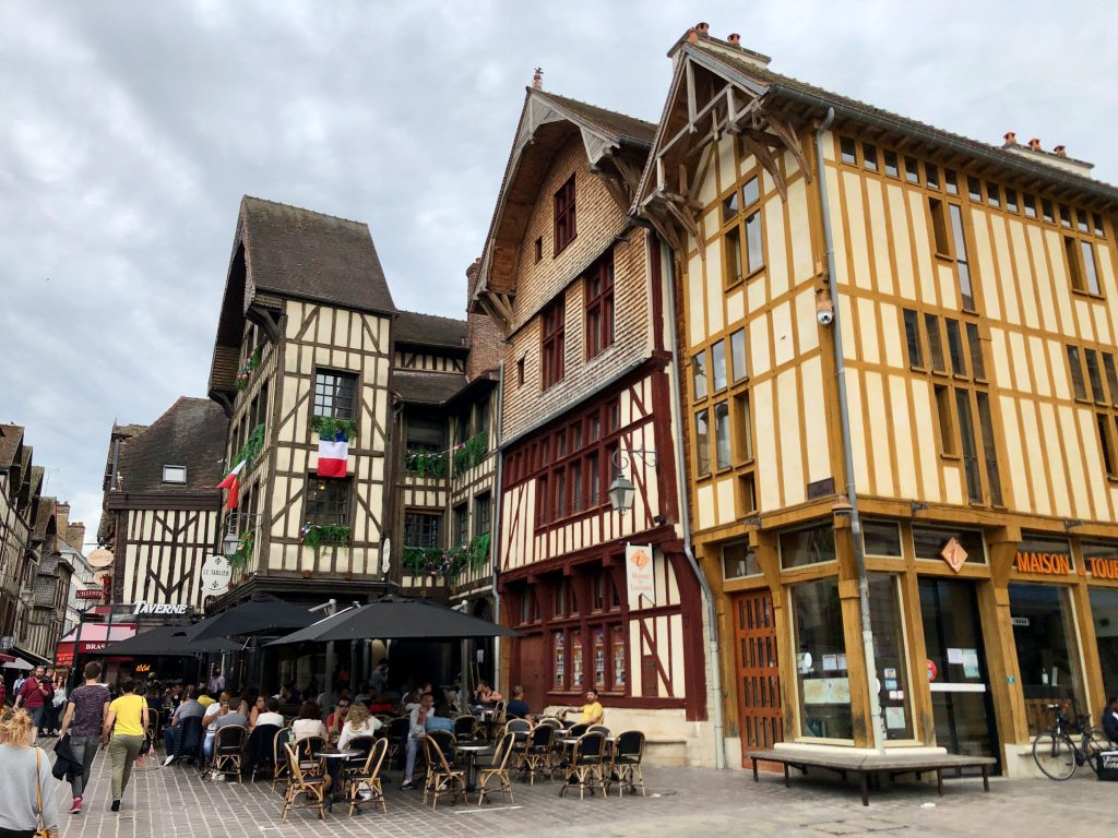 restaurant terrace in Troyes (France) in front of timber-framed buildings