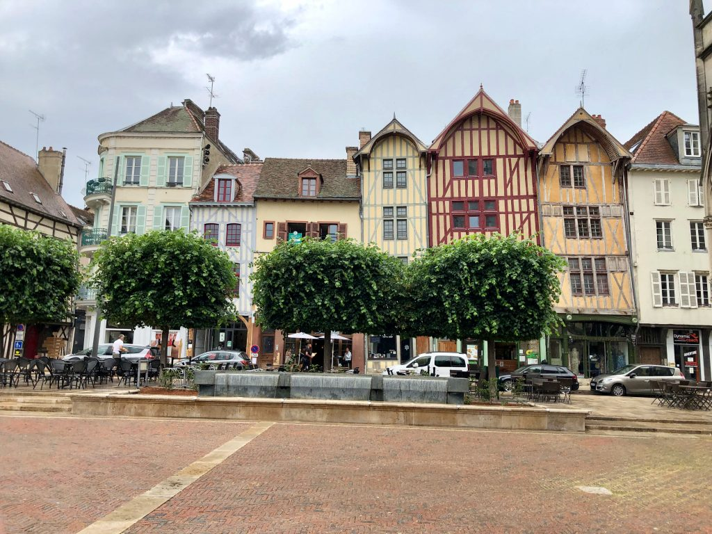 a row of half-timbered and colorful houses in Troyes, France