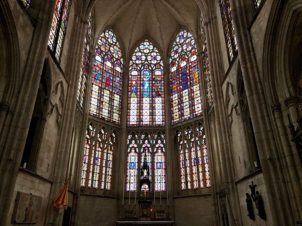 stained glass window inside Basilique Saint-Urbain in Troyes, France