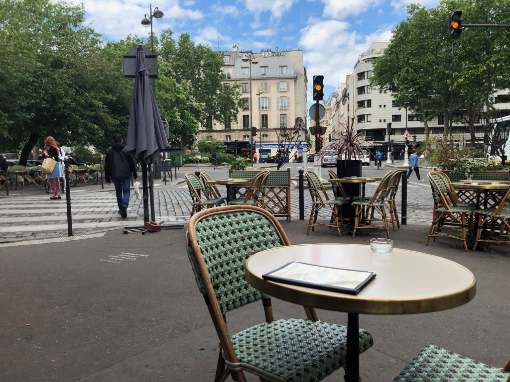 chairs and tables out on a café terrace in Paris