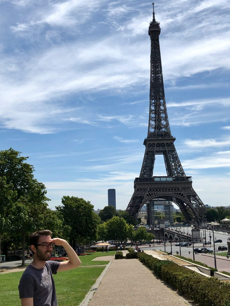 guy looking away from the Eiffel Tower