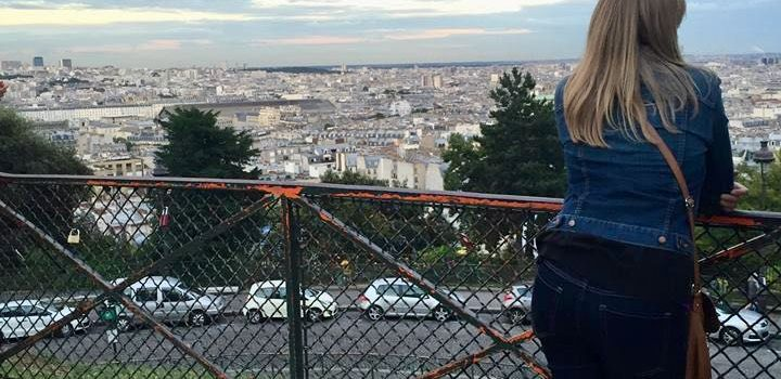 woman looking out over Paris from Montmartre