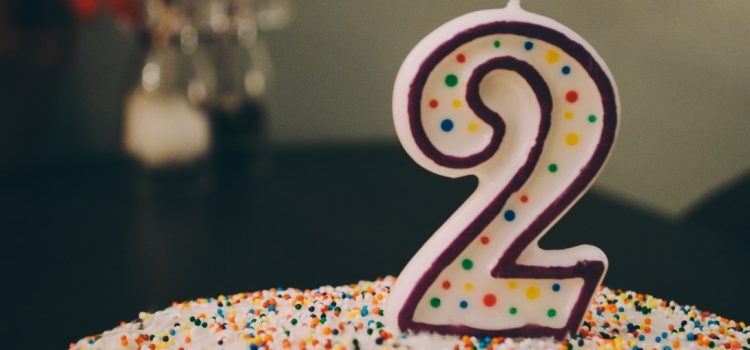 number 2 candle on a birthday cake